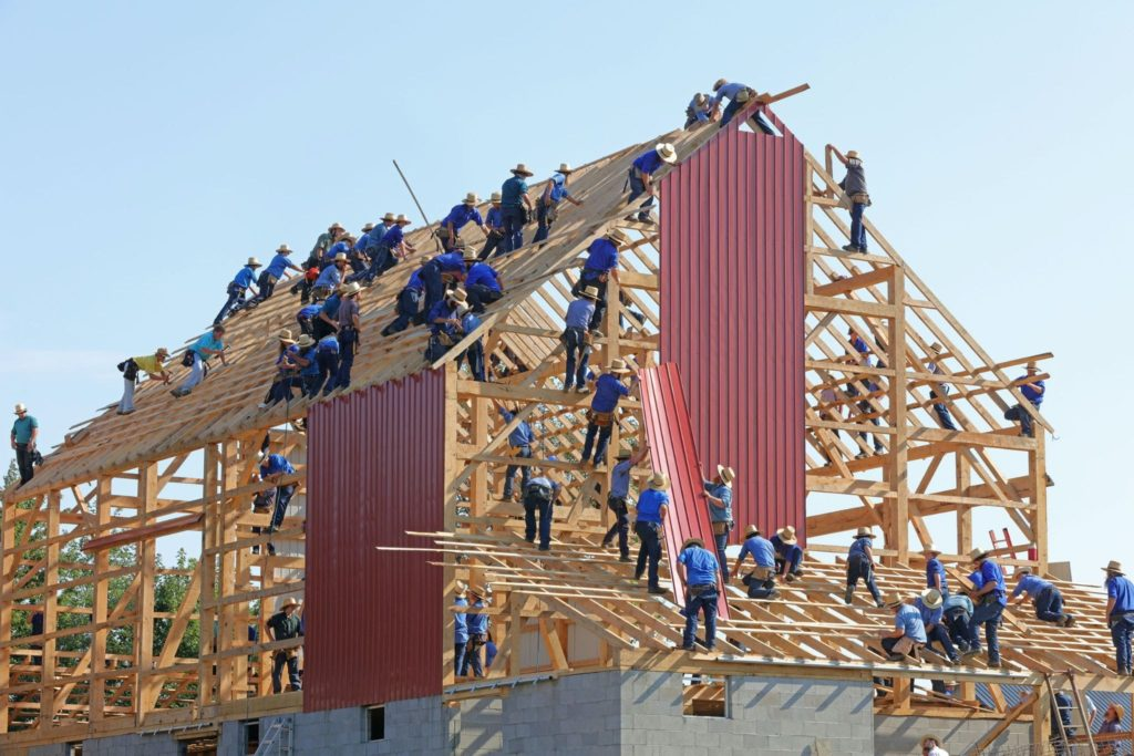 A group of worker with teamwork that uses technology and tools to build a house